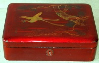 Vintage japanese lacquer box with crane and tree motif on the top.