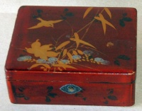 Vintage japanese lacquer box with bird and bamboo motif on the top.