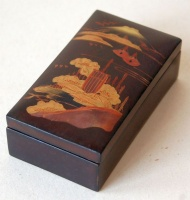 Vintage japanese lacquer box with mountain Fuji and landscape motif on the top.