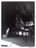210.     RAPAICH, RICHARD : EMKE café on the morning of 30. October, 1956. Later enlargement.